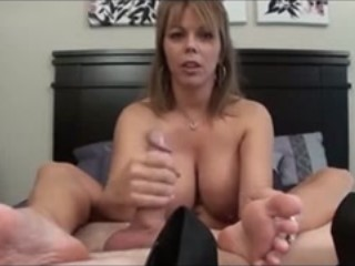 Big Breasted Cougar Works Her Skillful Hands On A Big Hard Cock