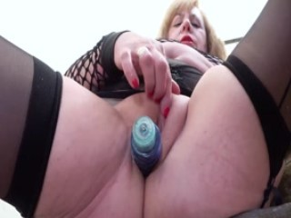 Mature Lady Playing Solo With Her Meaty Pussy