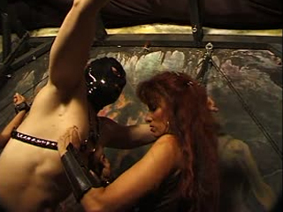 Mature Domina Plays With Her Slaves
