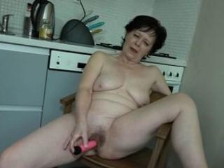 Granny Is Masturbating In Kitchen